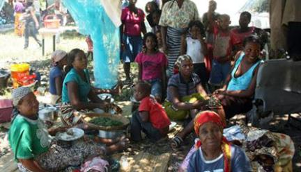 Catastrophic conditions after flood in Mozambique. People gather as they can