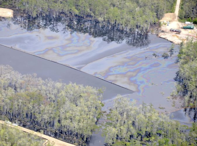 raibow sheen covers entire Bayou Corne Sinkhole louisiana april 2013