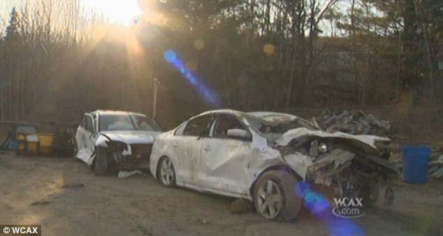 Aftermath: The cars were pelted with large rocks and filled with dirt, but the family managed to escape with little more than bumps, bruises and a broken arm