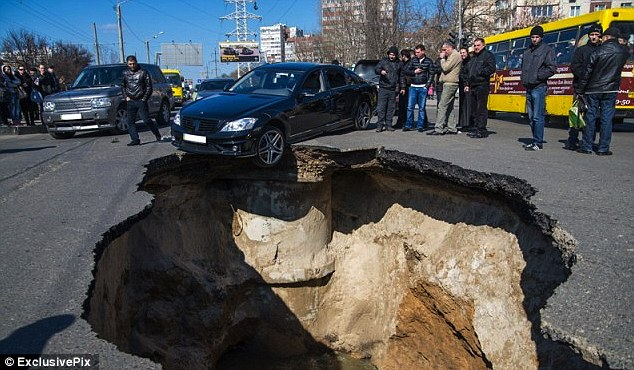 huge sinkhole plague in samara russia swallows car buses and kills residents