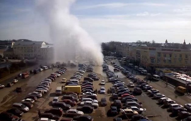 Meanwhile in Russia, a giant and enormous Hot Water Geyser erupted from a parking lot in Smolensk. Watch amazing video!, geyser, geyser eruption, geyser eruption russia, hot geyser eruption smolensk, Hot water geyser erupts in Smolensk Russia (VIDEO), geyser eruption video, video of geyser eruption in city, amazing geyser erupts in russian city video, explosion after geyser erupts in russia, huge hot geyser opens up in smolensk russia april 2013, Massive hot water geyser erupts in parking lot in Russia, strange phenomena, strange phenomena russia, geyser parking lot russia april 2013, geyser opens up in russia, geyser opens up in russia april 2013, geyser smolensk russia april 2013, geyser eruption smolensk 2013, geyser eruption russia 2013, geyser eruption smolensk russia 2013, geyser eruption, geyser, russia, smolensk, Huge hot water geyser erupts in parking lot in Smolensk Russia - April 11 2013 (VIDEO), Amazing video of a massive hot water geyser erupting from under a parking lot in Smolensk, Russia and spewing water and bricks 100 feet in the air. Amazing!