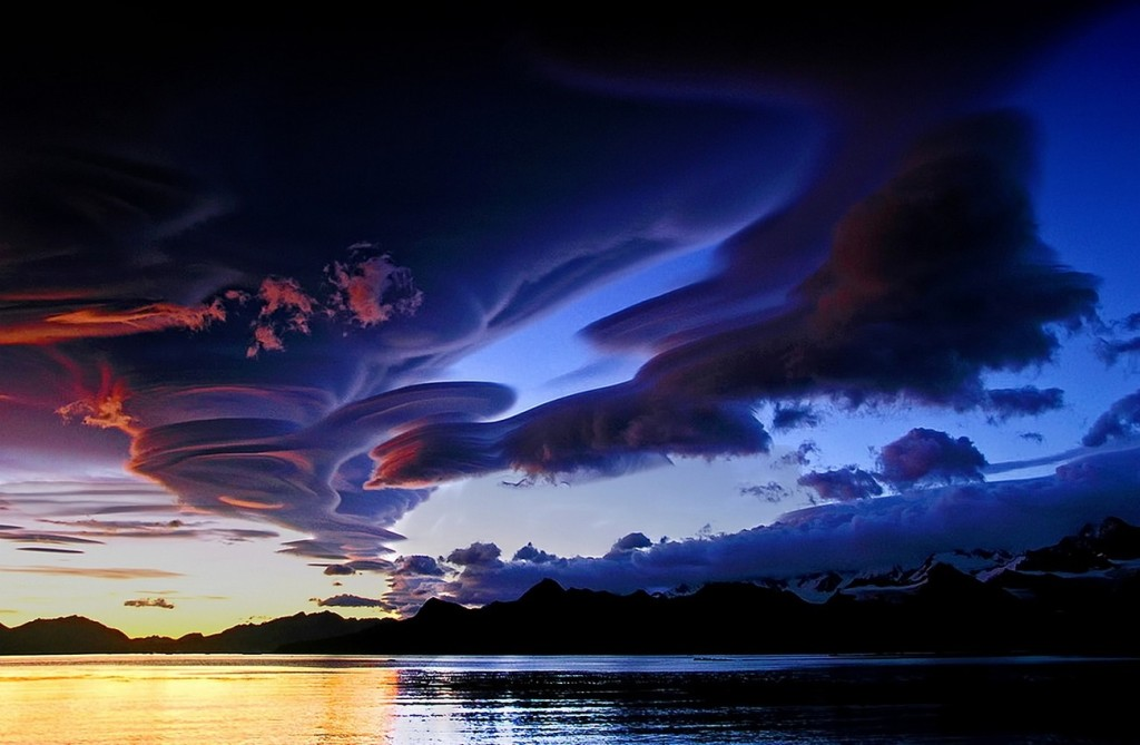 amazing lenticular clouds at night