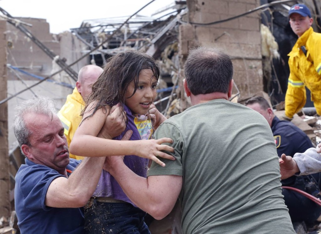 child taken away from school in moor oklahoma after tornado may 2013, A child is pulled from the rubble at Tower Plaza Elementary in Moore, May 20, 2013