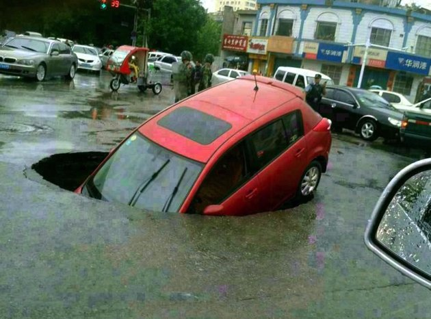 Huge Sinkhole Swallows Car and Family in Hetian, China – May 16 2013  8a18984c-6fcc-41d2-a6b9-76524c7d1dde_rexfeatures_2343787a