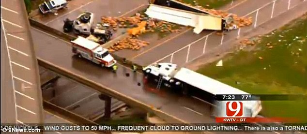 Overturned tractor-trailers are seen on Interstate 40 near Shawnee Oklahoma, truck destruction after tornado in oklahoma and kansas, tornado photo shawnee oklahoma may 2013, video tornado kansas and oklahoma may 2013, video tornado usa may 2013, photo tornado usa may 2013, Tornado devastation in Oklahoma may 2013, tornado, tornado devastation in Kansas and Oklahoma kills 1 and injures 20 may 19 2013, tornado devastation, tornado kansas may 19 2013, tornado oklahoma may 19 2013, tornado shawnee may 2013, tornado wilkinson may 2013, severe weather usa may 2013, severe weather oklahoma may 2013, severe weather kansas may 2013, extreme weather may 2013 usa, how do tornadoes form?, devastating tornado usa may 2013, tornado usa 2013, killer tornado usa 2013, tornado time in usa 2013