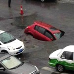 sinkhole china swallows car may 2013