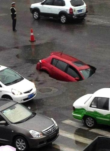 swallows car may 2013, sinkhole swallows car in China may 16 2013