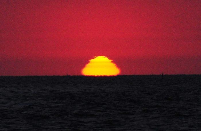 Jan Koeman weird sun in layers during atmosphere inversion