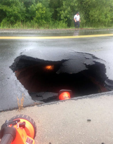 amazing sinkhole closes road in Gilead Sinkhole