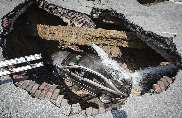giant sinkhole swallows a car in toledo ohio july 2013