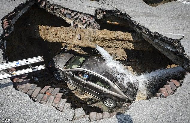 giant sinkhole swallows a car in toledo ohio july 2013