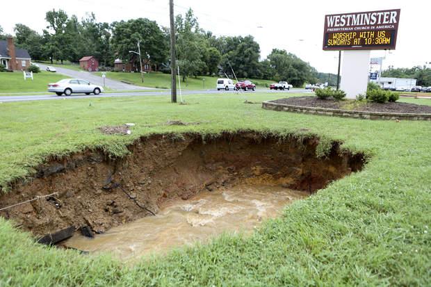 two sinkholes open up in fields in usa