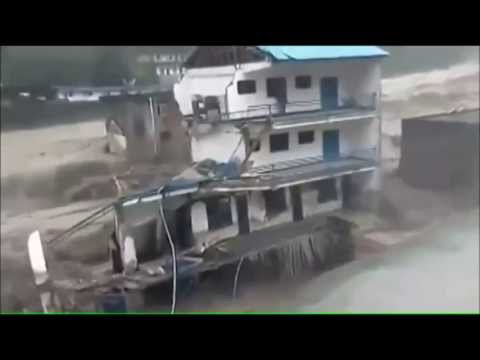 flash flood swallows building with man in it caught on video
