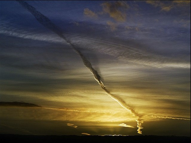 Parallel contrail blackline or black shadow, contrail with self black shadows at sunset