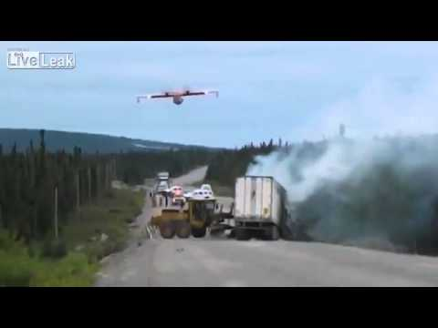 water bomber blows out a truck on fire on Canadian highway