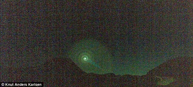 spinning vortex norway, Mysterious glowing spiral of light spins in the sky over Norway, Mysterious glowing spiral of light spins in the sky over Norway video, Mysterious glowing spiral of light spins in the sky over Norway pictures