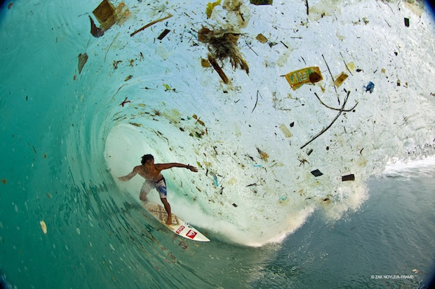 surfer Dede SURYANA surfing a trash-filled waves in Indonesia, sea pollution, pristine beach destructed by plastic and foam pollution in indonesia, sea pollution indonesia, surfing indonesia, Discover Untung Jawa also known as