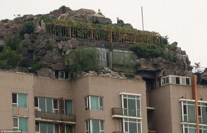 stunning architecture in china, stone fortress on top of apartment building in Beijing China, eccentric professor contructs stone villa on top of skycraper in china, amazing mountaintop villa in beijing