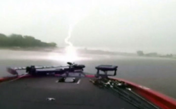 lightning footage, lightning video, lightning sound, lightning almost kills fishermen in Texas, lightning strike almost hist boat in texas