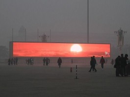 amazing news, amazing news china, breaking news china, china smog breaking news, strange news around the world, amazing news around the world, weird news, weird breaking news, links to weird breaking news, strange sounds news, smog china sunrise giant tv, In China, the smog is so strong that people cannot see the sky. The solution: large tv screens show sunsets and sunrises