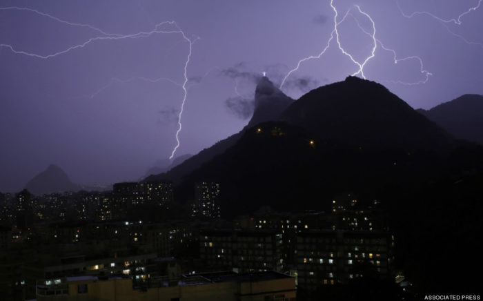 Brazil Rio lightning Storm 2014, Lightning storm over Rio de Janeiro strikes Christ the Redeemer statue, lightning storm rio january 2014 photo, Lightning storm over Rio de Janeiro strikes Christ the Redeemer statue, Christ the Redeemer statue lightning storm, Christ the Redeemer statue lightning strike, Christ the Redeemer statue photo, Christ the Redeemer statue lightning photo, Lightning bolts strike through the sky near Christ the Redeemer statue in Rio de Janeiro
