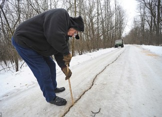 frost quake, ice quake, cryoseism, frost quake forms giant crack (100 feet) in frozen road in wisconsin on January 13 2014, frost quake 2014, ice quake 2014, cryoseism 2014, What are ice quakes?, how ice quakes form, ice quake rattles wisconsin, loud booms in Wisconsin believed to be created by frost quakes, strange earth phenomenon: frost quakes, ice quakes: strange earth phenomenon, frost quake 2014, frost quake rattles wisconsin january 2014, frost quake usa 2014, Frost quake forms giant crack (100 feet) in frozen road in wisconsin on January 13 2014