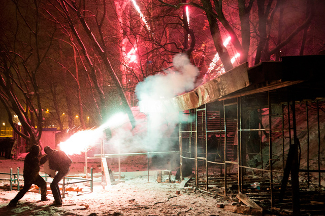 fireworks during ukraine protest, fireworks during ukraine protest January 2014, Ukraine urban war photo January 2014, Ukraine protest 2014 video, urban war in Ukraine January 2014, Protesters use fireworks during clashes with police in central Kiev, Ukraine, late Tuesday, Jan. 21, 2014