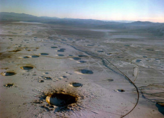 Nevada Test Site (NTS), Nevada nuclear test site craters, photo of Nevada nuclear test site craters, moonslandscape: Nevada nuclear test site craters, where did the usa conduct nuclear tests, where nuclear test bombs tested in US, Nevada Test Site (NTS) photo, discover Nevada Test Site (NTS), Nevada Test Site (NTS) nuclear tests site, nuclear test site in US, us nuclear tests site is Nevada test site, NTS nuclear test site in Nevada, photo of NTS, nevada test site photographs, discover nevada test site (nuclear test site) in images, images of Nevada test site, picture of Nevada test site, Neveada test site looks like a moon landscape, moonscape in Nevada, Nevada crater moonscape, Nevada Test Site (NTS) Moonscape. Photo: ESRI, The Nevada Test Site is the location where the United States conducting atomic testing, Earthquakes caused by underground nuclear explosions on Pahute Mesa, Nevada Test Site