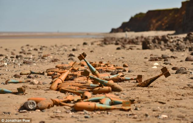 bombs found on UK beach, New danger from the floods is revealed after storms unearth wartime BOMBS on beaches, sinkhole created by Britain's extreme weather video, bomb extreme weather britain, bomb unearthed by extreme weather in Britain, WWII bombs revealed by UK storm 2014, unexplosed bombs revealed by UK storms 2014, sinkhole on Paignton Beach after UK storm 2014, uk storm 2014 reveal hidden hazards, hidden hazards revealed by UK storms February 2014, UK storms 2014: bombs and anti-tank defences discovered, and bombs found on UK beach, 'Sinkhole' appears on Paignton Beach, Ammunition has been unearthed by the terrible weather that battered Britain's coasts, Second World War anti-tank defences emerge from below the sand of storm-lashed beach,