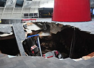 sinkhole swallows corvette, corvette swallowed by huge sinkhole inside corvette museum, Huge sinkhole swallows corvette at national corvettes at the National Corvette Museum in Bowling Green in Kentucky - February 12 2014. Photo: National Corvette Museum, corvette museum sinkhole, sinkhole corvette museum, kentucky corvette museum sinkhole, sinkhole swallows eight corvettes at corvett national museum in Bowling green - February 2014, corvette national museum sinkhole, sinkhole at corvette national museum 2014, sinkhole news 2014: Corvette national museum, corvette national museum sinkhole 2014