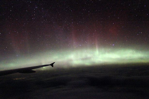 aurora photo plane, plane northern lights photo 2014, amazing northern lights uk 2014 from plane, northern lights from plane over uk 2014, Aurora borealis during BA flight over UK - March 2 2014. Photo: PA