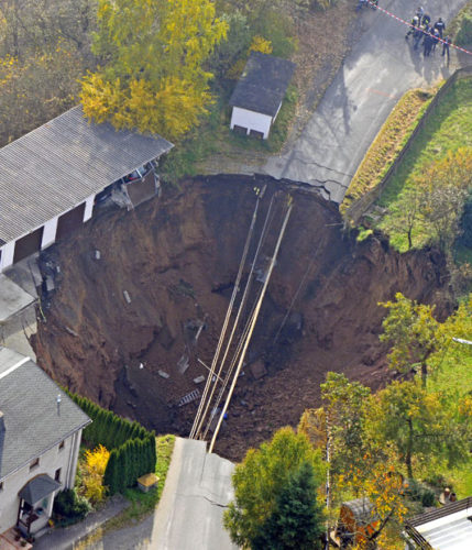 Sinkhole Schmalkalden Germany 2010, most impressive sinkhole around the world photo, photo of impressive sinkhole, sinkhole, sinkhole photo, amazing sinkhole, sinkhole uk 2014, sinkhole photo, photo of sinkholes, largest sinkholes around the world, photo of sinkhole around the world, sinkhole photography, sinkhole picture, sinkhole compilation, sinkhole, An aerial photo shows a massive crater that appeared in a residential street in Schmalkalden, Germany, in November 2010 Picture: Jens Meyer/AP