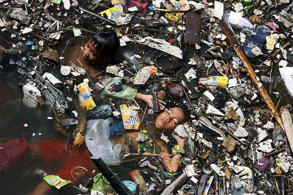 citarum river trash, citarum river pile of trash, most bpolluted river in the world, citarum river pollution photo, The Citarum river is so polluted you cannot see the water under the trash