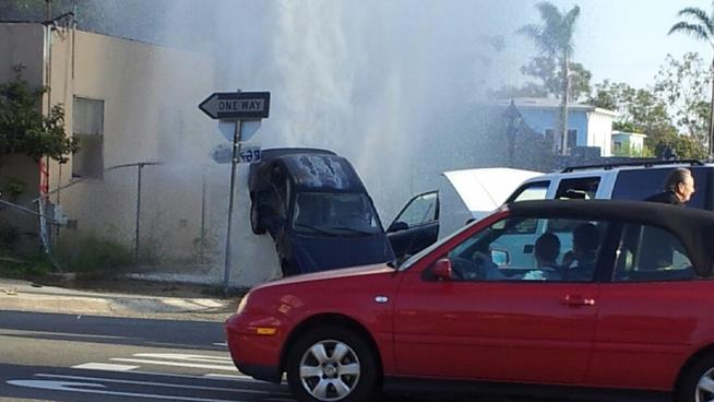 Geyser Broken Hydrant Lifts Car 10 Ft Off Ground in San Diego, California, geyser broken hydrant, san diego car accident march 2014, geyser hydrant 2014, geyser in USA 2014, Geyser use car accident, geyser lifts car in the air, broken hydrant lifts car in the air video, video of gyser in San Diego, geyser hydrant video san diego 2014, Geyser car into hydrant san diego california