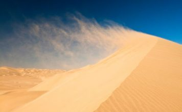 sand dune sound, singing sand, singing sand phenomenon, what is the sound of sand dunes, sand sound