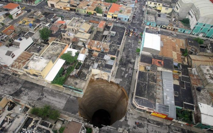 sinkhole guatemala city 2010, sinkhole, sinkhole photo, amazing sinkhole, sinkhole uk 2014, sinkhole photo, photo of sinkholes, largest sinkholes around the world, photo of sinkhole around the world, sinkhole photography, sinkhole picture, sinkhole compilation, sinkhole, In May 2010, a huge, almost perfectly circular, sinkhole measuring 66 feet (20 m) wide and 100 feet (30 m) deep suddenly opened up, swallowing a three-storey building and a house in Guatemala City. Authorities blamed heavy rains caused by tropical storm Agatha. Picture: Guatemala's Presidency, Luis Echeverria/AP