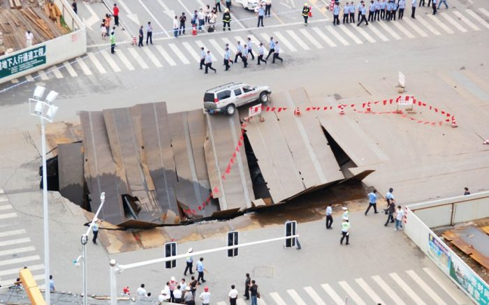 sinkhole heifei China 2009, most impressive sinkhole around the world photo, photo of impressive sinkhole, sinkhole, sinkhole photo, amazing sinkhole, sinkhole uk 2014, sinkhole photo, photo of sinkholes, largest sinkholes around the world, photo of sinkhole around the world, sinkhole photography, sinkhole picture, sinkhole compilation, sinkhole,, In August 2009, a road in Hefei, Anhui Province, China, suddenly sank, causing one taxi and three motobikes to fall into the hole Picture: Top Photo Group / Rex Features