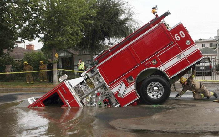 sinkhole la fire engine 2009, most impressive sinkhole around the world photo, photo of impressive sinkhole, sinkhole, sinkhole photo, amazing sinkhole, sinkhole uk 2014, sinkhole photo, photo of sinkholes, largest sinkholes around the world, photo of sinkhole around the world, sinkhole photography, sinkhole picture, sinkhole compilation, sinkhole, In September 2009, four firefighters escaped injury when their fire engine sunk into a large hole caused by a burst water main in the San Fernando Valley, Los Angeles Picture: Nick Ut/AP