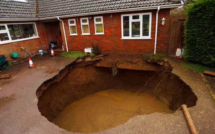 sinkhole, sinkhole photo, amazing sinkhole, sinkhole uk 2014, sinkhole photo, photo of sinkholes, largest sinkholes around the world, photo of sinkhole around the world, sinkhole photography, sinkhole picture, sinkhole compilation, sinkhole , sinkhole in the driveway of a house in Walter's Ash, Buckinghamshire. Picture: Reuters