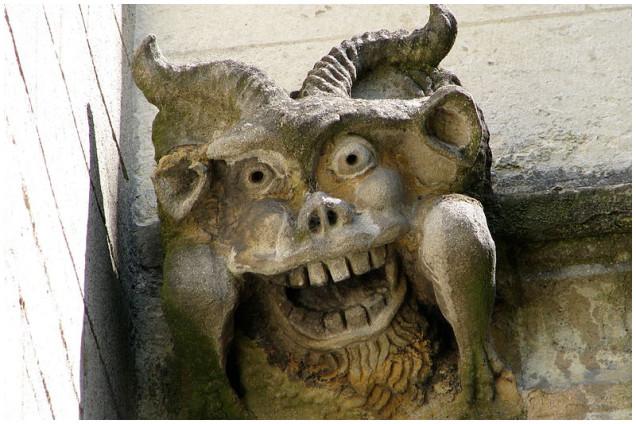 devil gargoyle, weird gargoyle, science-fiction gargoyle, alien gargoyle, The devil in person: Gargoyle on Magdalen College in Oxford. Photo: The land of shadow
