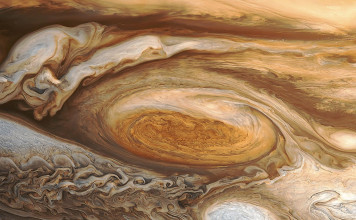 jupiter storm, largest storm in solar system, jupiter cyclone, The Great Red Spot shot by Voyager 1 in 1979 reveals a huge hurricane-like storm in Jupiter's southern hemisphere. Photo: NASA, amazing spece weather: jupiter's storm, strange space weather: Jupiter cyclone, Deadliest Space Weather - Biggest Storm in the Solar System, Deadliest Space Weather, Biggest Storm in the Solar System