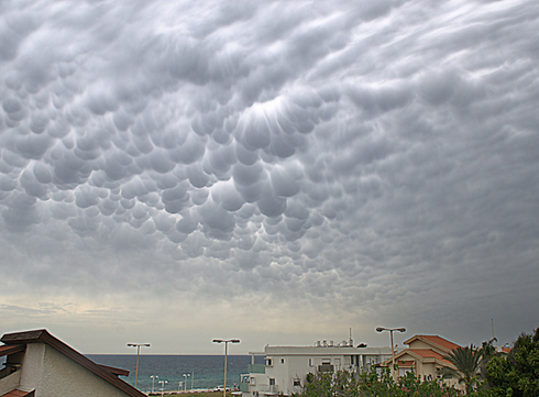 Mammatus clouds, Mammatus clouds latest news, strange clouds news: mammatus clouds spotted over Israel april 2014, mammatus clouds Israel photo, photo of mammatus clouds in Israel, Israel mammatus clouds photo and video april 2014, mammatus clouds photo april 2014 israel, best mammatus clouds photo april 2014, mammatus clouds sightings, mammatus clouds video april 2014, Mammatus clouds over Nahariya. Photo: Rativo family