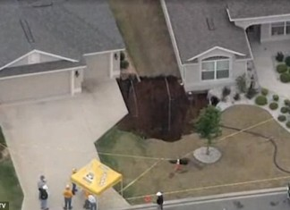 huge sinkhole almost swallows two homes in florida april 20 2014, Sinkhole stabilized in Villages neighborhood, sinkhole almost swallows two homes in Villages neighbourhood, Massive sinkhole threatens homes in Sumter County, Massive 50-foot sinkhole springs up in Florida threatens to engulf two homes, Two vacant homes threatened by a huge sinkhole in Florida on April 20, 2014, sinkhole almost swallow two homes in Florida - April 20 2014, huge sinkhole swallows homes in florida april 20 2014, us sinkhole florida april 20 2014, florida sinkhole april 201 2014, monster sinkhole florida april 2014