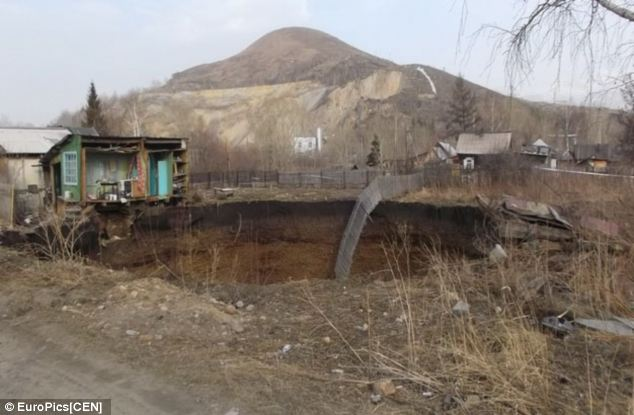 house swallowed by sinkhole in Kazakhstan, house swallowed by sinkhole in Ridder, terrifying moment a sinkhole swallows a house with a newborn baby in it video, young mother saves newborn before house is swallowed by a massive sinkhole in Ridder Kazakhstan april 2014 video, sinkhole swallows home and almost kills newborn Ridder in eastern Kazakhstan, Ridder in eastern Kazakhstan terrifying sinkhole april 2014, Mother and baby safe after escaping house that fell into a sinkhole, monster sinkhole swallows family home in Ridder Kasakhstan - april 2014, monster sinkhole swallows family home in Ridder Kasakhstan - April 2014. Photo: EuroPics, Young mother flees with her newborn baby as sinkhole claims her house, Anastasia Tatarnikov sinkhole, sinkhole in Ridder kasakhstan april 2014, Mother and baby safe after escaping house that fell into a sinkhole, Young mother flees with her newborn baby as sinkhole claims her house, video of young mother saves newborn before house is swallowed by a massive sinkhole in Ridder Kazakhstan april 2014,