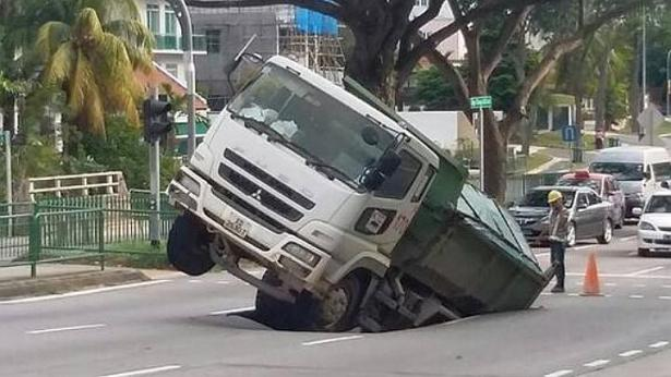 video singapore sinkhole on Upp Changi Road East video, singapore sinkhole on Upp Changi Road East video, video of singapore sinkhole on Upp Changi Road East video april 24 2014, sinkhole swallows truck in singapore, singapore sinkhole swallows truck, huge sinkhole swallows truck in singapore, This sinkhole swallowed a truck in Singapore - April 24 2014. PHOTO: ANDRE GIAM/ TWITTER, Cave in on Upper Changi Road on April 24 2014, sinkhole on Upper Changi Road swallows truck on April 24, 2014, Cave-in at Upp Changi Road East swallows truck, truck swallowed by sinkhole on Upp Changi Road East in Singapore april 24 2014, video singapore sinkhole april 2014, singapore sinkhole on Upp Changi Road East video