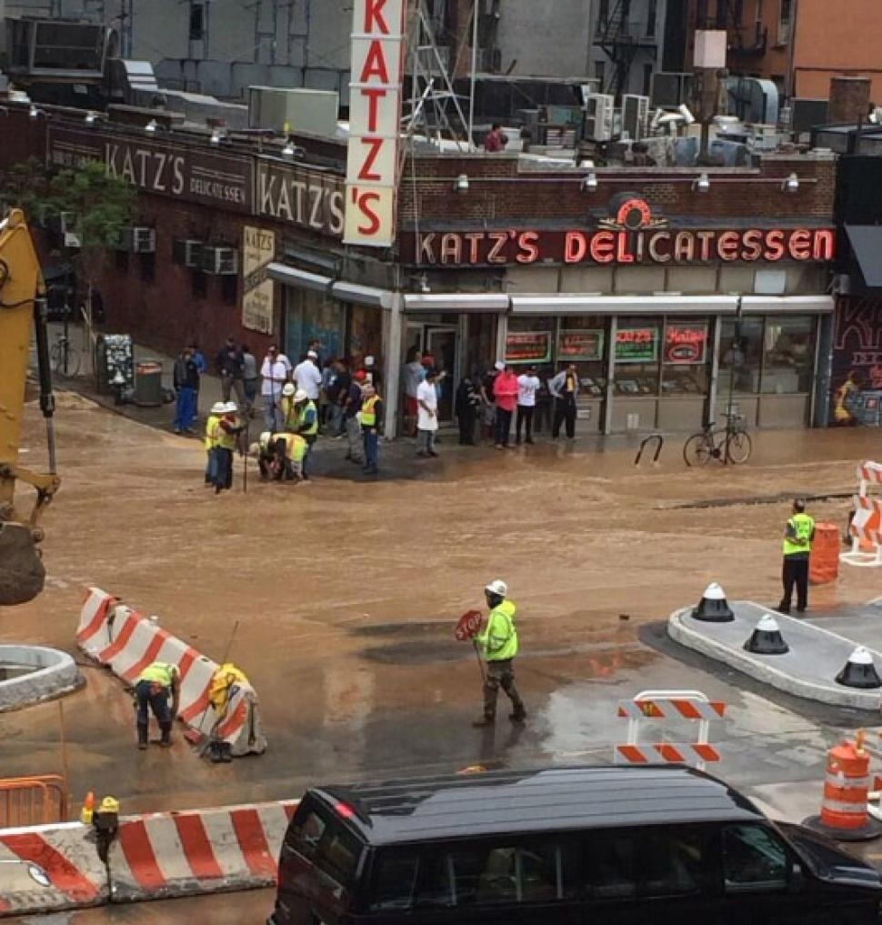 Katz's Delikatessen floods may 2014, sinkhole and floods at Katz's Deli, Katz's Deli sinkhole and flooding may 22 2014, Flooding in front of Katz's Delikatessen in New York after watermain break on May 22, 2014. Photo by MARCUS SANTOS/NEW YORK DAILY NEWS