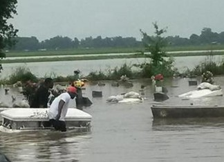 strange and weird news: caskets unearthed by flooding in Belle Rose Louisianna on May 28 2014, strange phenomenon: floods unearth casket in Belle rose assumption parish louisianna may 2014, caskets unearthed by floods louisianna belle rose may 2014, caskets louisianna floods news may 28 2014, Caskets unearthed by floods in Louisianna, louisianna flooding: caskets unearthed by floods in Belle Rose louisianna may 28 2014, caskets floods belle rose louisianna may 28 2014, caskets unearthed by massive floodings in Lousisianna, assumption parish caskets unearthed by floods, MASSIVE FLOODING UNEARTHS CASKETS in Louisianna may 29 2014, casZombie Floods: Caskets float away from their graves after flooding in southern Louisianna. Photo: 9Reports