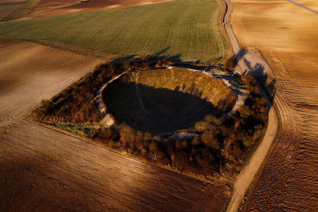 photo for 100th anniversary end of WW I, WW I 100th anniversary, 100th anniversary of the Armistice in 1918 photo bomb craters WW I, Scars from World War I Battle of the Somme in France: The nearly 70 feet deep Lochnagar Crater. Photo from the photo exhibition Fields of Battle—Lands of Peace in Paris by Michael St. Maur Sheil
