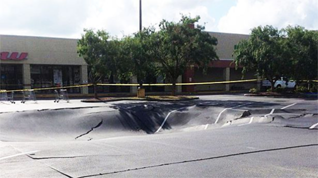sinkhole, sinkhole florida, sinkhole florida news may 2014, sinkhole florida may 2014 news, sinkhole winter haven florida parking lot news, sinkhole winter haven florida video, video of massive parking lot sinkhole may 2014, sinkhole swallows parking lot in winter haven florida may 29 2014 video, Sinkhole in Winter Haven parking lot - May 29 2014, massive sinkhole swallows parking lot in Winter Haven florida may 29 2014, parking lot swallowed by sinkhole in Winter Haven florida may 2014, massive sinkhole winter haven florida may 2014, sinkhole, cave-in, sinkhole news, sinkhole winter haven may 2014, This monster sinkhole opened up in Winter Haven, Florida on May 29, 2014... It's growth has now slowed down. Photo: WFLA