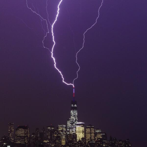 lightning strike One World Trade Center May 23 2014 photo, photo of lightning strike One World Trade Center May 23 2014, lightning strike One World Trade Center May 23 2014, thunderstorms New York May 23 2014, lightning one trade center may 23 2014, lightning storm NY may 23 2014, lightning world trade center NY may 23 2014, Two bolts of lightning strike One World Trade Center May 24 2014. Photo: Two bolts of lightning strike One World Trade Center May 24 2014